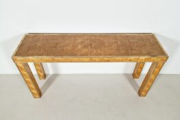 Woven rattan console table with brass